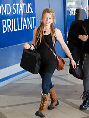 Crystal Bowersox hit the airport in a pair of lace up sheepskin boots. The American Idol star looked ready for snow in the heavy duty boots.