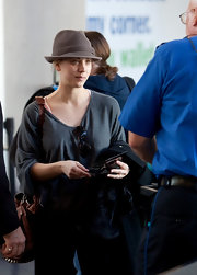 Kaley donned a classic fedora to the airport.