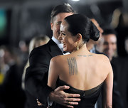Angelina Jolie wore her hair tightly pulled back into a version of a chignon for the world premiere of 'The Curious Case of Benjamin Button'. The look was absolutely elegant.