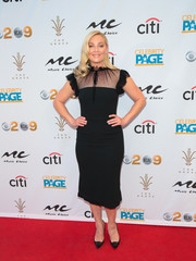 Elisabeth Rohm kept it prim in a little black dress with a sheer neckline and ruffle sleeves at the 2018 Grammy viewing party.