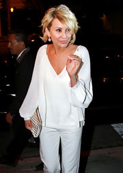 Chelsea Kane looked angelic in a white chiffon blouse with billowing sleeves.