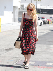 "Dakota Fanning was a retro darling in her black and red ""Persimmon"" dress from Reformation."
