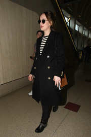 Dakota Johnson finished off her travel attire with a tricolor leather crossbody bag by Michael Kors.