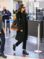 Dakota Johnson cut a chic figure at LAX in a shearling-trimmed wool coat by The Row.