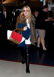 Dakota Fanning packed her airport essentials in a color-blocked tote.