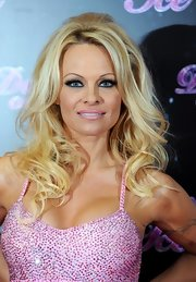 Pam had her signature Malibu Barbie thing going on at the Dancing on Ice 2013 Photocall with her bottle-blond tresses in airy curls.