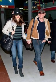 Rachel Weisz capped off a stylish travel look with teal suede booties.