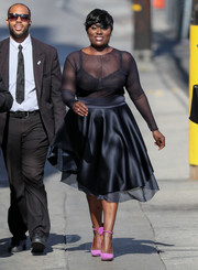 Danielle Brooks added a heavy dose of elegance with a layered black satin skirt.
