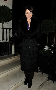 Dannii Minogue kept her evening look glamorous and sophisticated with this fur-trimmed evening coat.