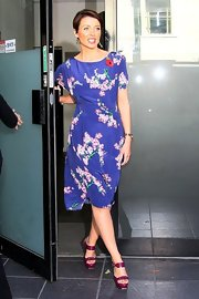 Dannii played up the colorful design of her floral frock with a pair of candy-colored sandals.
