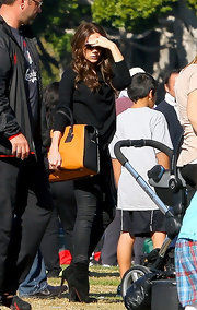 Victoria Beckham added a dash of color to her monochromatic street-wear with a yellow color-block Victoria tote.