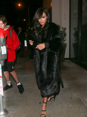 Naya Rivera left Catch Restaurant looking glam in a black faux-fur coat by House of CB.