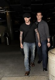David Beckham kept his travel look classic and simple with a black tee and jeans.
