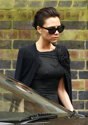 Victoria is classic and stunning in black. For this ensemble she is wearing a modern wayfarer sunglass.
