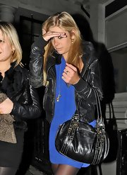 Chelsy Davy coordinated her black leather jacket to a matching buckled purse.