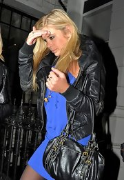 Chelsy Davy toned down her blue mini dress with a black leather bomber jacket.
