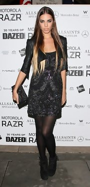 Amber Le Bon opted for a studded leather purse to style her 'Dazed and Confused' party outfit.