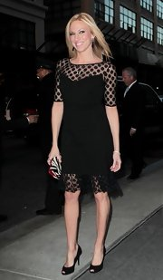 Debbie Gibson paired black peep toe pumps with her dotted dress while out for an evening in NYC.
