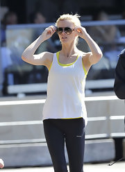 Brooklyn went for a workout in a basic tank layered over a yellow sports bra.