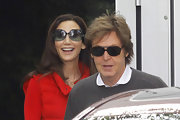 Paul McCartney wore a pair of oval shades to keep the sun out of his eyes while traveling in London.