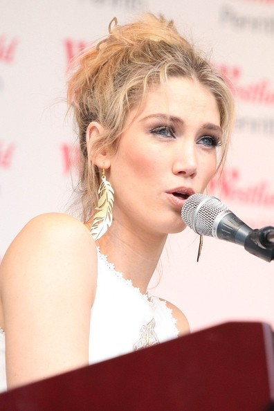 Delta Goodrem pulled her hair up in a messy updo for a performance in Sydney.