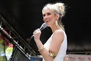 Delta Goodrem wore a chic gold leaf-shaped bracelet on her upper arm while performing in Sydney.