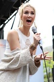 Delta Goodrem complemented her lovely dress with an intricate gold bracelet during a performance in Sydney.
