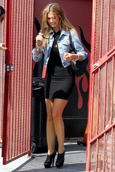 Delta Goodrem was spotted a tattoo parlor in Hollywood wearing a fierce pair of black peep-toe ankle boots.