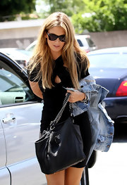 Delta Goodrem complemented her jean jacket and LBD combo with a black Prada chain-strap bag while out and about in Hollywood.