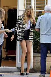 Delta Goodrem teetered on a fierce pair of spiked black Christian Louboutin platform pumps during a promotional shoot.