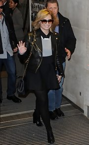 Demi stuck to a full black skirt for her flirty punk look in London.
