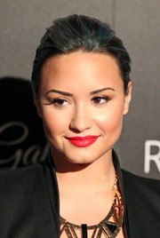 Demi Lovato brightened up her beauty look with a rich red lip color when she attended the Redlight Traffic Dignity Gala.