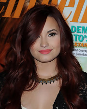 Demi Lovato wore a gold choker necklace with beaded accents at the unveiling of her 'Seventeen' magazine cover.