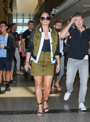 Demi Lovato sported a tricolor Veronica Beard bomber jacket with mesh sleeves while catching a flight.