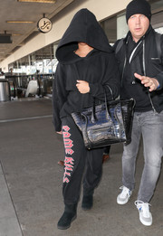 Demi Lovato went incognito in a black hoodie while making her way through LAX.