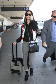 Demi Moore completed her comfy outfit with a pair of gray and black capris.