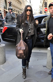 Demi Moore stepped out in Paris bundled up in layers and carrying a metallic handbag.