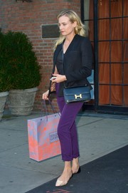 Diane Kruger went shopping wearing a black blazer with purple pants.