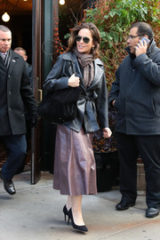 Diane Lane showed off her fall style with this black leather pea coat while out in New York City.