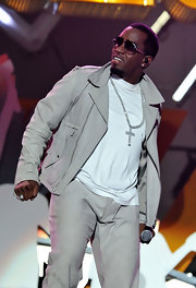 Sean Combs spruced up his ensemble with a huge cross pendant necklace while performing at Wembley Arena.