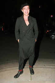 John Galliano went for an all black look while hitting a party in New York.