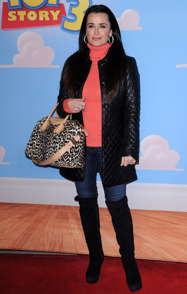 Kyle Richards' added flair to an otherwise straight-forward look with a leopard print bowler.