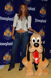 Tyra Banks showed some midriff at Disneyland's Anniversary in this funky blazer.