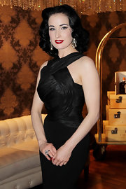 Dita Von Teese wore her hair in long waves and curls at the launch of My Cointreau Travel Essentials. Her lovely style can be duplicated with hot rollers and hairspray.