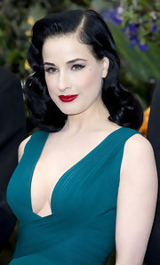 Dita Von Teese created her sultry look with black liquid liner and long wispy false lashes.