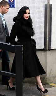 Style maven Dita perfected her retro style in a fur-trimmed coat paired with satin ruffle-embellished pumps.