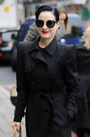 Dita Von Teese loves a good pair of cat eyes like these gold embellished ones.