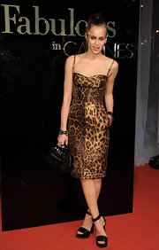 Alice Dellal looked wildly chic in Cannes wearing this Dolce & Gabbana leopard print dress.