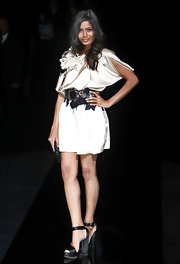 This pendant embellished leather Dolce and Gabbana Belt is such a great accent to the Dolce dress that comes straight off the runway from the designers spring 2009 collection.