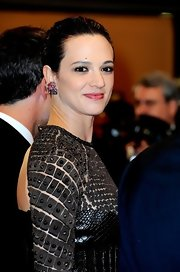 Asia Argento wore a pair of heart-shaped ruby earrings to complete her 'Dracula 3D' Cannes screening look.